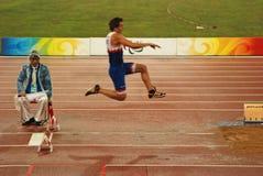 Concurrence du long saut des hommes Image libre de droits
