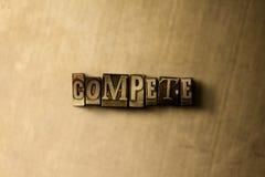 CONCURRENCENT - le plan rapproché du mot composé par vintage sale sur le contexte en métal Photographie stock libre de droits
