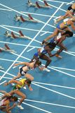Concurrents des femmes de 100m Photographie stock