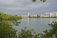 Condado lagoon, San Juan, Puerto Rico. View from the southern side of the Condado lagoon in San Juan, Puerto Rico, showing hotels and apartment buildings stock photo