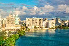 Condado in San Juan Puerto Rico. View of Condado area of San Juan Puerto Rico with bay and buildings on a day with clouds and sun stock image