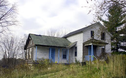 Condemned And Abandoned Home. Another farm bites the dust! The family is gone the house remains condemned and abandoned Stock Photos