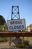 Condemned bridge. Old condemned suspension bridge in the desert royalty free stock photography
