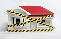 Condemned drug contiminated home concept with a model New Zealan. D NZ weatherboard villa house Royalty Free Stock Image