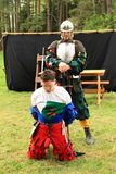 Condemned landsknecht. Man with a soldier behind that will make the execution during theatre performance at Spring Landsknecht Camping at Bohdalov (Czech Stock Photography