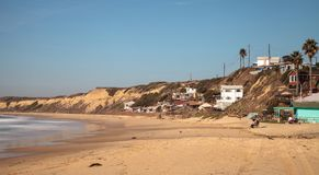 Condemned old Beach cottages line Crystal Cove State Park beach Royalty Free Stock Photos