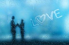 Condensatie op glas die een liefdewoord vormen royalty-vrije illustratie
