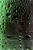 Condensation. On green drinks bottle Royalty Free Stock Image