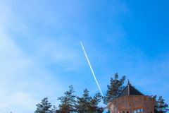 Condensation trace, reactive track - visible trace emerging in atmosphere behind moving aircraft under certain. Atmospheric conditions against background of Royalty Free Stock Images