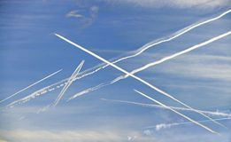 Condensation trails of airliners Royalty Free Stock Photos