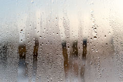 Condensation on a Window with Blue Background Stock Image