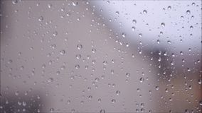 Condensation on a windowpane. Condensation and raindrops on a windowpanen stock footage