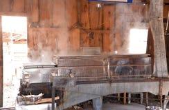 Condensatore d'acciaio per sciroppo d'acero in funzione Fotografia Stock