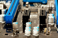 Condensators on laptop motherboard close view Royalty Free Stock Images