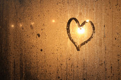 Condensed Love. Heart of love in glass condensed water stock images