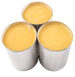 Condensed Milk VIII. Condensed milk in tin can over white background royalty free stock photo