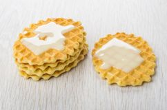 Condensed milk on wafer cookies on table. Condensed milk on wafer cookies on wooden table royalty free stock photos