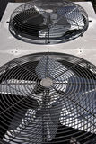 Condenser Fans. Above coiling coils in an HVAC split system stock photo