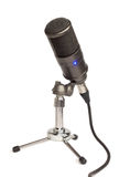 Condenser mic on a table stand. Condenser microphone on table (isolated Royalty Free Stock Images