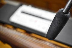 Condenser microfon recording Guqin music. Condenser shotgun microphone recoding Chinese beautiful sound from a Guqin string instrument. (focus on microphone Royalty Free Stock Photos