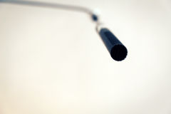 Condenser microphone hanging from the ceiling Stock Image