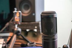 Condenser microphone in a recording studio royalty free stock photos