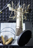 Condenser microphone  in vocal recording room. Condenser microphone prepared for singer in vocal recording room Royalty Free Stock Photography
