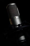 Condenser tube microphone. On a black background Stock Photography