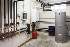 Condensing boiler gas in the boiler room Royalty Free Stock Photo