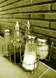 Condiment Bottles On Cafe Tabletop Stock Images