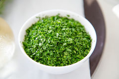 Condiment. Crushed coriander in a bowl. Royalty Free Stock Photo