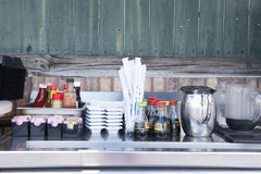 Condiment station an an outdoor restaurant Stock Image