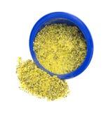 Condimento de la pimienta del limón que desborda el cuenco azul Fotografía de archivo