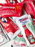 Condimentos da ketchup da corrente de restaurante do fast food Imagem de Stock