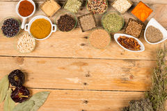 Condiments background on a rustic table Royalty Free Stock Photography