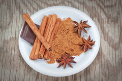 Condiments Baking anise, cinnamon and chocolate. Royalty Free Stock Images