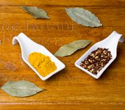 Bay leaves with curcuma and chili in pieces. royalty free stock photo