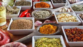Condiments. Colorful herbs and spices selection. Aromatic ingredients on wood table Stock Photo