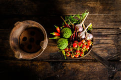 Condiments and spices for creative cooking on dark rustic wooden Stock Image