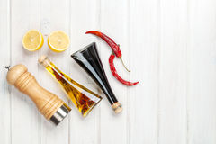 Condiments and spices over white wooden table Royalty Free Stock Photography