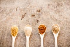 Condiments in spoon Stock Photos