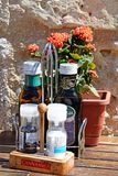 Condiments on a wooden table, Gozo. Royalty Free Stock Image