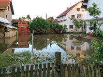 Condition of house with a yard after floods Royalty Free Stock Photos