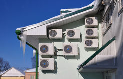 Conditioners. Several air conditioners on the wall of an office building royalty free stock photography
