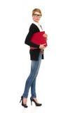 Condizione femminile con il raccoglitore di anello. Fotografie Stock