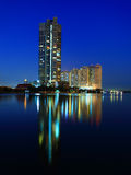Condo along the Chao Phraya water reflections Stock Image