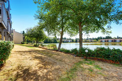 Condo apartment homes overlooking a small lake. Northwest, USA Royalty Free Stock Photo
