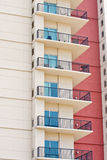 Condo Balconies and Red Wall Royalty Free Stock Photos