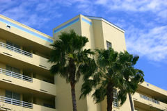 Condo building. With palm trees and bright blue sky stock photography