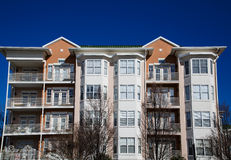 Condo Building on Blue Stock Image